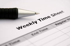 Weekly time sheet. Close up of weekly time sheet Stock Images