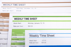Weekly time sheet forms for payroll stock image