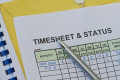 Weekly timesheet. With pen. Timekeeping record and payroll Stock Image