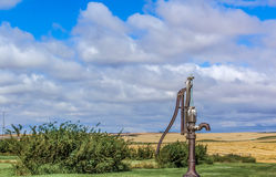 Well Pump. Cast iron water pump on the prairie Stock Photo