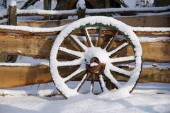 Weel in the Snow. Wooden weel in the snow Stock Photography
