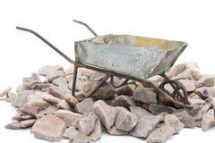 Weelbarrow con las rocas alrededor de él fotografía de archivo libre de regalías