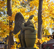 Weeping Angel at autumn. Statue of weeping angel, necropolis of Donskoy monastery, Moscow, Russia stock photos