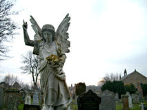 Weeping angel. A stone angel in a Scottish cemetary stock images