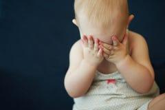 Weeping baby girl stock image