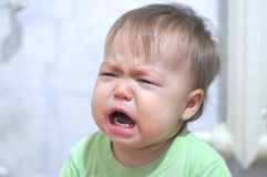 Weeping baby portrait Royalty Free Stock Photos