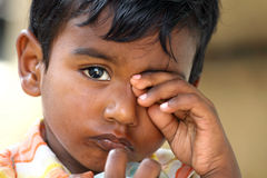 Weeping Boy. Rubbing his eyes Royalty Free Stock Image