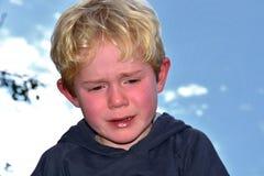 Weeping boy Stock Photos