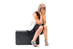 Weeping girl sitting on trunk - isolated Stock Image