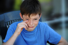 Weeping teenager boy. Teenager boy feeling unhappy and weeps Royalty Free Stock Photography