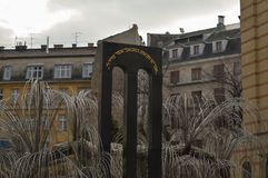 The weeping willow tree in the courtyard memorial of the Hungarian Jewish Martyrs of Cent. BUDAPEST, HUNGARY - DECEMBER 31, 2017: The weeping willow tree in the stock photos
