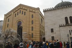The weeping willow tree in the courtyard memorial of the Hungarian Jewish Martyrs of Cent. BUDAPEST, HUNGARY - DECEMBER 31, 2017: The weeping willow tree in the stock photography