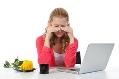 Weeping woman at a computer. Isolated on white background Stock Images