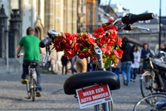 Weer een Auto minder. A bike in the city of Ghent in Belgium on a trip in the spring of 2013 Royalty Free Stock Photos