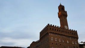 Weergeven van de voorgevel van Palazzo Vecchio in Florence in het zonsonderganglicht royalty-vrije stock afbeelding