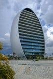 Weergeven van het nieuwe ovale gebouw op de horizon van Limassol royalty-vrije stock afbeelding