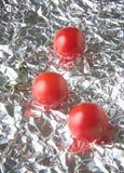 Weerspiegelde tomaten Stock Afbeeldingen