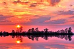 Weerspiegelde zonsondergang Stock Foto