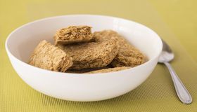 Weet-Bix in White Bowl with Spoon. Stock Photos