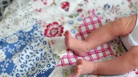 Weet infant baby legs. Newborn child lying in stroller in park. Beautiful summer walk. Weet infant baby legs. Newborn child lying in stroller in park. Beautiful stock video