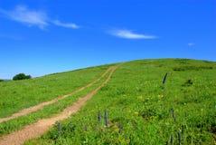 Weg aan de heuvel Stock Foto's