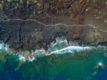 Weg durch Lava u. Meer stockbild
