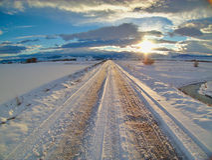 Weg eines Winter-Sonnenuntergangs Stockbild