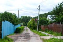 Weg in het dorp Stock Fotografie