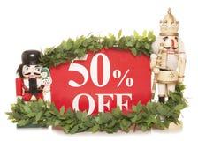 50% weg von den Weihnachtsverkaufszeichen- und -nussknackerverzierungen Lizenzfreies Stockbild