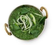 Weganinu i jarosza indyjska kuchnia rozdaje, zielona szpinak polewka Obrazy Royalty Free