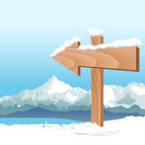 Wegweiser mit Winter Lizenzfreies Stockfoto
