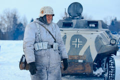 Wehrmacht officier in winter camouflage with the Sd.Kfz. 251 Sonderkraftfahrzeug 251. Royalty Free Stock Photography