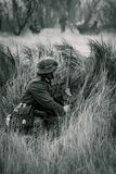 Wehrmacht soldier Germany with a rifle in ambush royalty free stock images