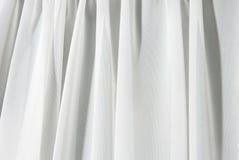Weiß drapiert Hintergrund Stockfoto