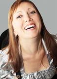 Weiß-gezahntes Lächeln Stockfoto
