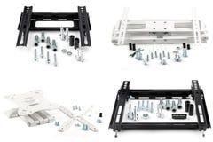 Weiß zwei schwarz und zwei baute Klammern für Fernsehen auf einem Weiß auseinander lizenzfreies stockfoto