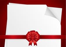 Weißbuch mit einem roten Band Stockbild