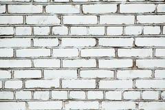 Weiße Backsteinmauer des Hintergrundes mit dunklen Nähten stockfoto
