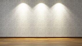 Weiße Backsteinmauer mit drei Scheinwerferlichtern Stockfotografie