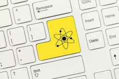 Weiße Begriffstastatur - gelber Schlüssel mit Atomenergie symbo stockfotos