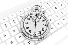 Weiße Computertastatur mit Stoppuhr Stockbilder