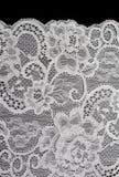 Weiße dekorative Spitze mit Muster Stockfotografie