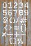 Weiße Farbe der Alphabetzahl Farbauf hölzernem Retro- Farbhintergrund vektor abbildung