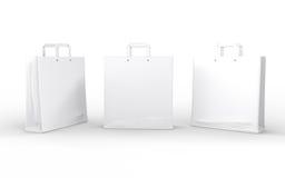 Weiße Glanzpapiertasche lokalisiert auf Weiß mit Beschneidungspfad Lizenzfreies Stockfoto