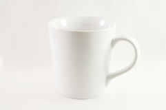 Weiße Kaffeetasse auf einem weißen Hintergrund Lizenzfreie Stockfotografie