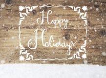 Weiße Kalligraphie frohe Feiertage, gealterter Hintergrund, Schnee, Schneeflocken Lizenzfreies Stockfoto