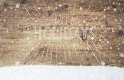 Weiße Kalligraphie frohe Feiertage, Weinlese-Hintergrund, Schnee, Schneeflocken Stockbilder