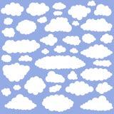 Weiße Karikaturwolken Lizenzfreies Stockfoto