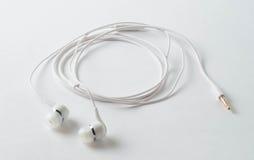 Weiße Kopfhörer Stockfoto