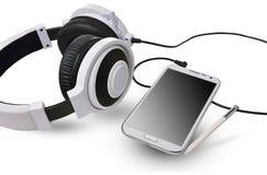 Weiße Kopfhörer und intelligentes Telefon Lizenzfreie Stockfotografie